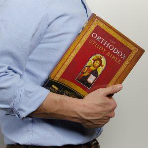 man holding the orthodox study bible