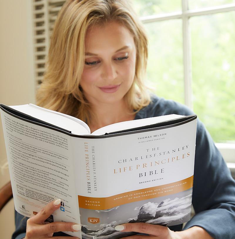 woman reading KJV Charles F. Stanley Life Principles Bible