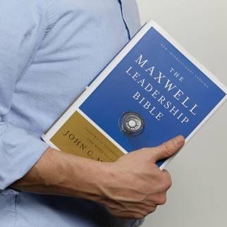 man holding NIV Maxwell Leadership Bible