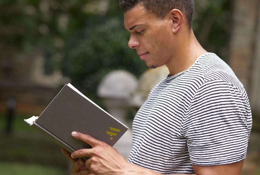 Man reading Ancient Modern Bible