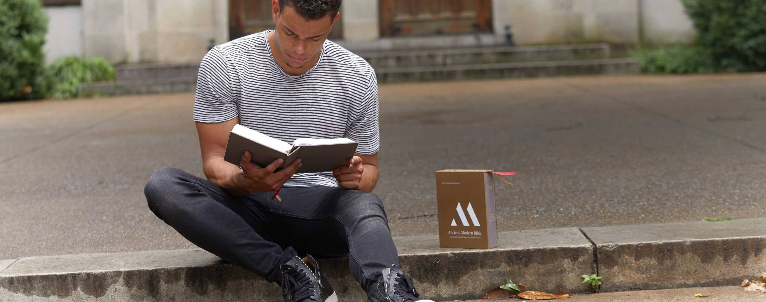 Man reading the Ancient Modern Bible