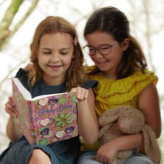 Girls reading ICB Sequin Bible