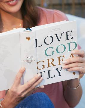 Woman reading NET Love God Greatly Bible