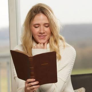 Woman reading NKJV Thinline Bible