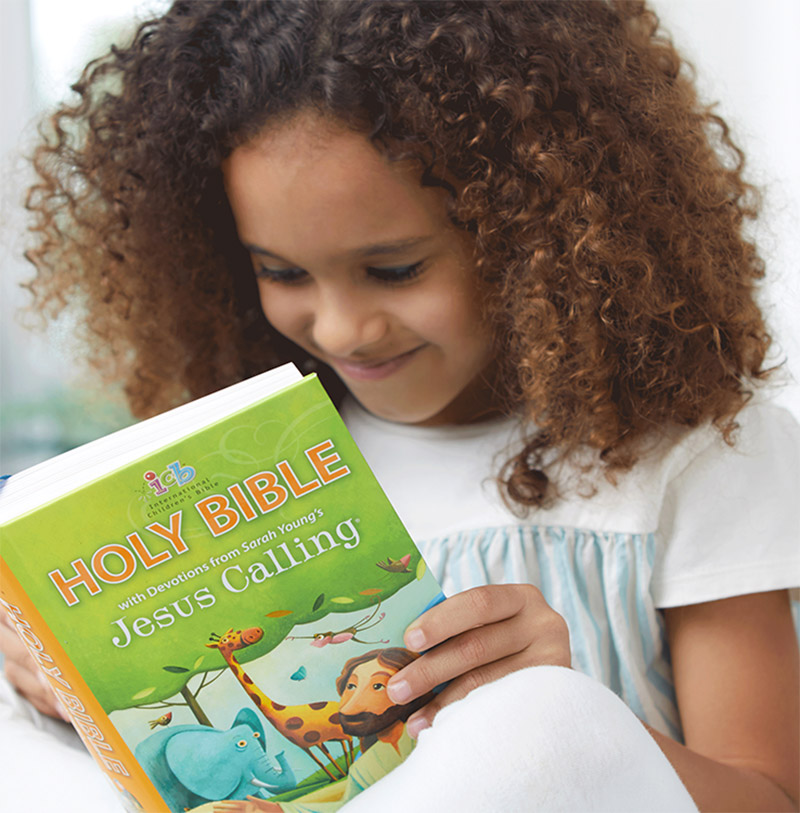 girl reading ICB Jesus Calling Bible for Children
