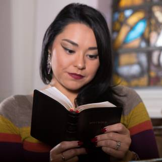 Woman reading a KJV Compact Bible