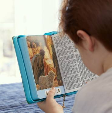 boy reading Seaside Bible